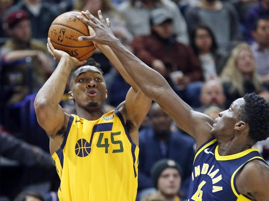 Guard Victor Oladipo, right, has been spectacular for the post-Paul George Pacers, while rookie Donovan Mitchell of the Jazz, left, whom the Pistons passed on selecting, looks to be the steal of the draft.
