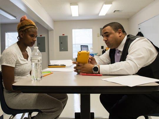 Jordan Coleman works with math teacher Devin Smith