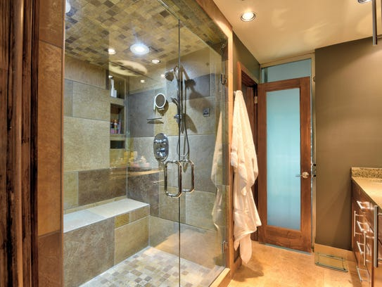 Master bath features shower that doubles as steam shower
