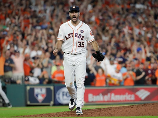 Houston Astros starting pitcher Justin Verlander reacts after striking out the side during the eighth inning of Game 2 of baseball's American League Championship Series against the New York Yankees Saturday, Oct. 14, 2017, in Houston.
