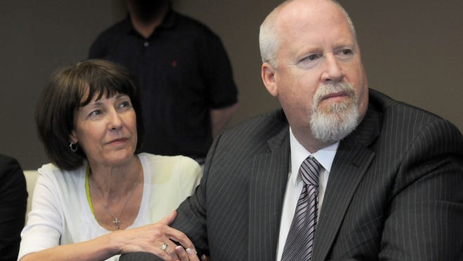 Annette and Harvey Whittemore listen as his attorney speaks during a news conference on May 29, 2013.