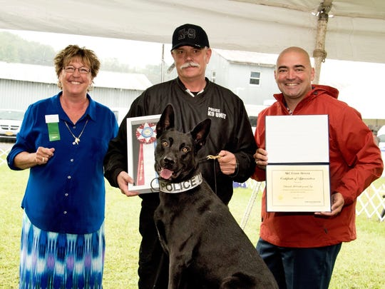 From left, Vicki Kubic, Tioga County Kennel Club; Officer