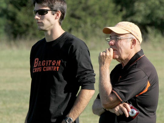 Brighton cross country Coach Bob Ritsema, right, speaks with next year's coach Chris Elsey.