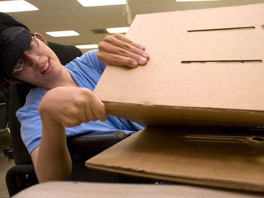 Caren Griffith assembles cardboard dividers for boxes at Mesa's Freestone Rehabilitation Center in 2008.