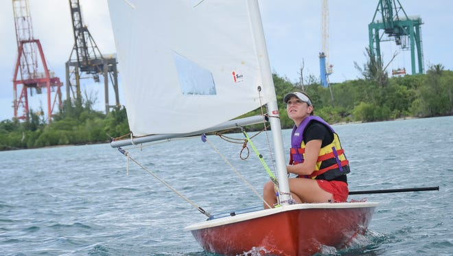 In this file photo, Ali Nusbaum sails a laser sailboat around a training course in Apra Harbor.