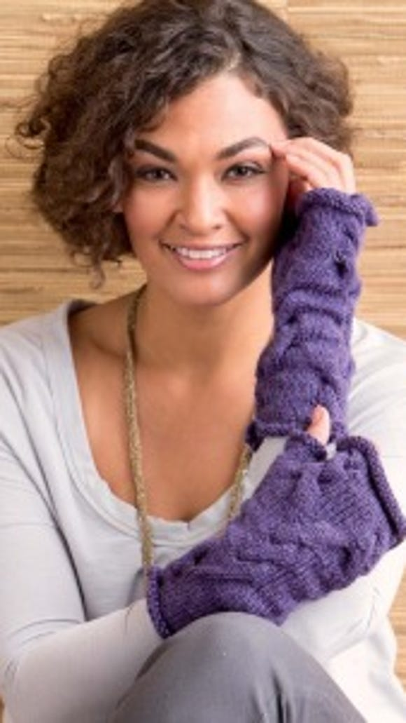 These grapevine mitts really appeal to me I think the cables and rolled fabric would make them toasty warm.