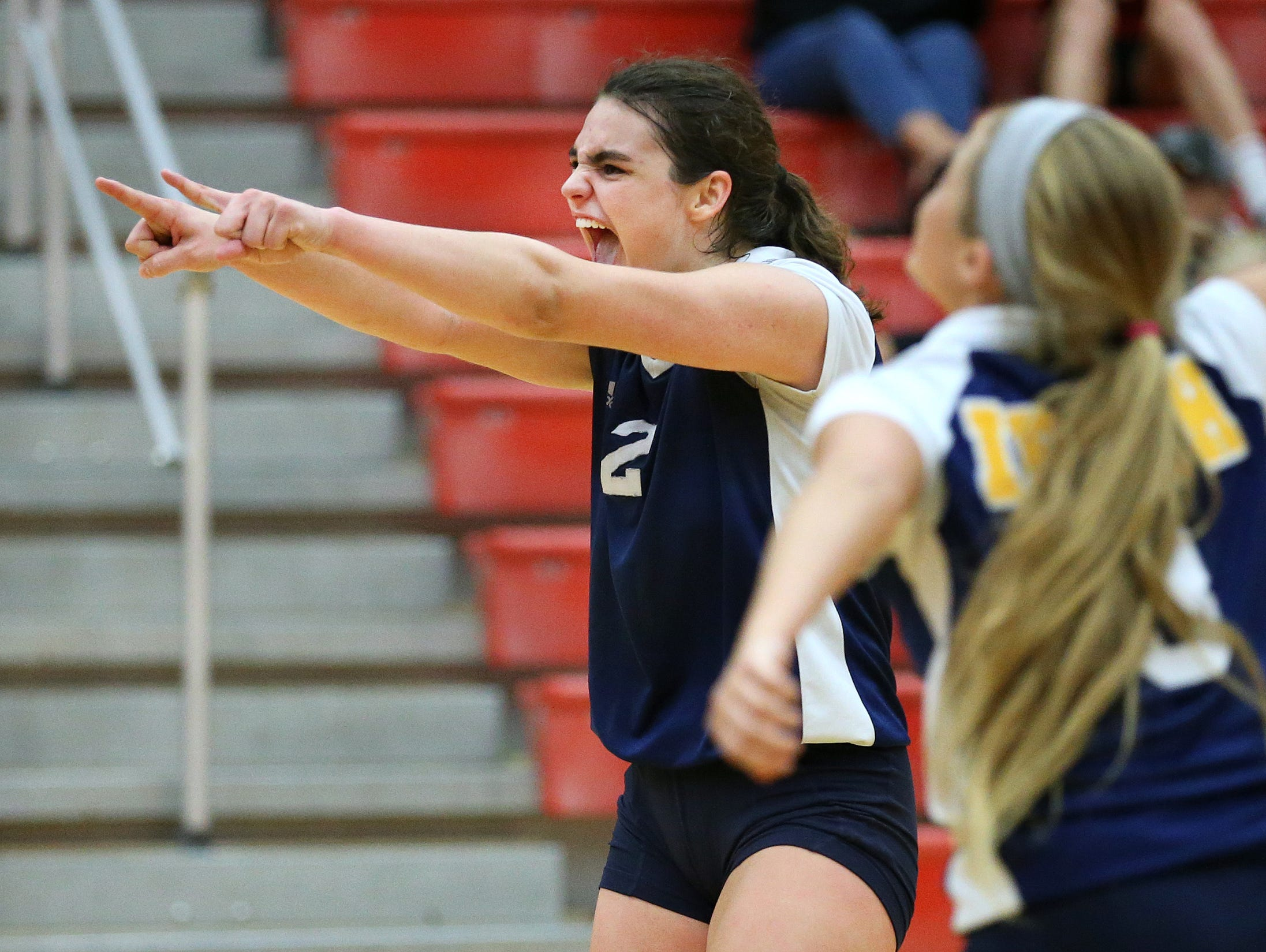 Cathedral's Maria Schorr screams after winning a point against Center Grove during their match, August 25, 2015.