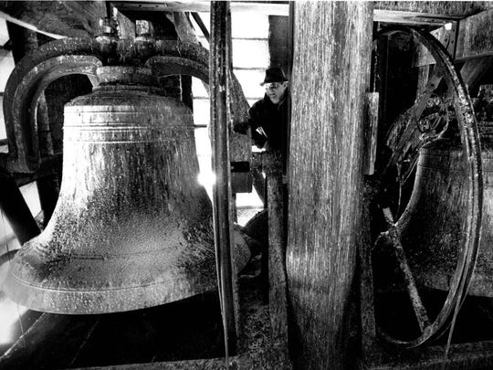 Ted Fleth inspects the state of the bell tower interior at Holy Redeemer Church in this 1989 file photo.
