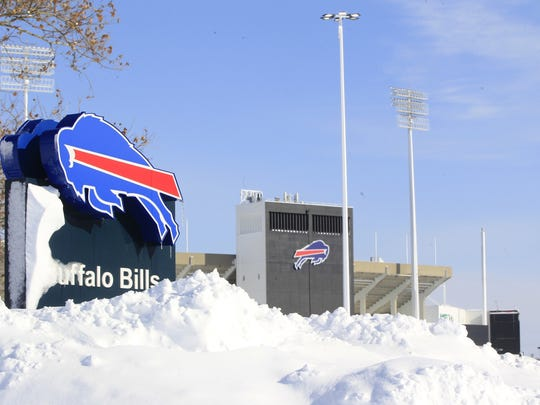 Snow covers a sign at Ralph Wilson Stadium, home of