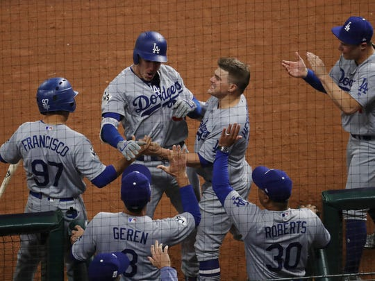 Los Angeles Dodgers first baseman Cody Bellinger (35) celebrates with teammates in the dugout after hitting a three-run home run against the Houston Astros in the fifth inning in game five of the 2017 World Series at Minute Maid Park.