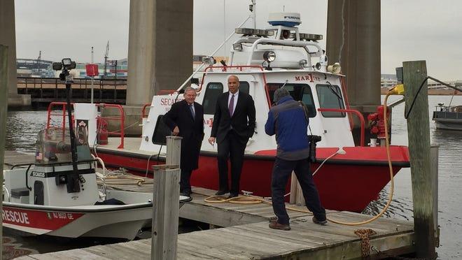 New Jersey's two Democratic U.S. Senators, Robert Menendez and Cory Booker, left and middle, respectively, take a tour of the Secaucus Public Safety Marina before a news conference Friday morning. The pair announced an agreement with the Federal Emergency Management Agency on major changes regarding flood insurance and superstorm Sandy victims.