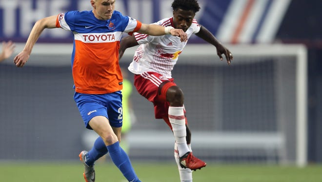 FC Cincinnati forward Jimmy McLaughlin (20) dribbles the ball up the field in the first half during the USL soccer match between the New York Red Bulls II and FC Cincinnati, Saturday, Sept. 16, 2017, at Nippert Stadium in Cincinnati.