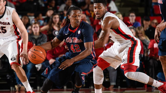 Guard Stefan Moody (42) is defended by Georgia guard Kenny Gaines (12) during the Rebels' road game last Saturday. Moody has returned to health as the Rebels play Mississippi State at home on Wednesday.