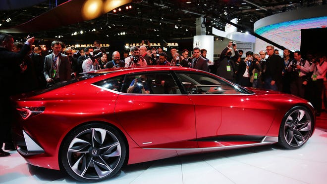 The international media rush to surround the Acura Precision concept luxury sedan after it is revealed during the 2016 North American International Auto Show held at Cobo Center in downtown Detroit on Tuesday, Jan. 12, 2016. The interior features rear seats that look more like lounge chairs. Regina H. Boone /Detroit Free Press