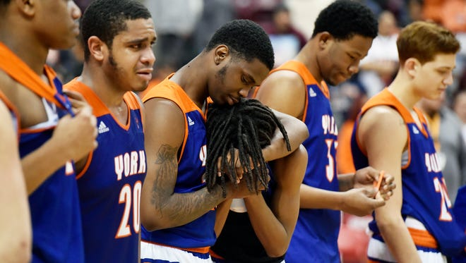 York High's Randy Baker comforts Edward Minter during the runner-up medal ceremony in the second half of the PIAA District 3 Class 5A boys' basketball championship game Thursday, March 1, 2018, at the Giant Center. York High lost 69-62 to Milton Hershey in the Bearcats' fifth district championship game since 2010.