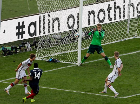 Germany's goalkeeper Manuel Neuer, second from right, makes a save after a shot by France's Blaise Matuidi, second from left, during the World Cup quarterfinal soccer match between Germany and France at the Maracana Stadium in Rio de Janeiro, Brazil, Friday, July 4, 2014. (AP Photo/Thanassis Stavrakis)