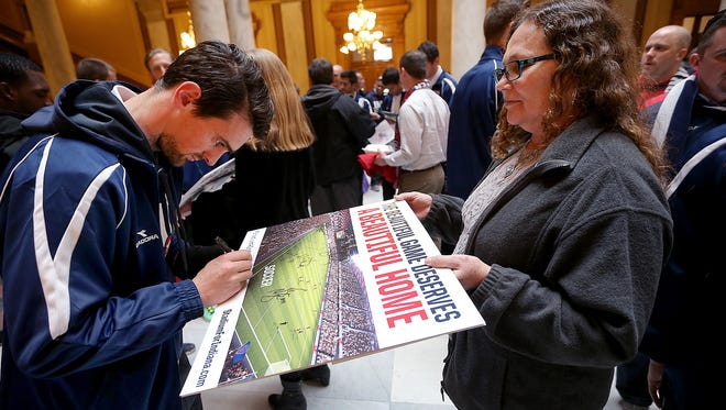 A Stadium for Indiana Rally was held in the South Atrium of the Indiana Statehouse on March 19, 2015. Indy Eleven soccer fans were able to meet-and-greet the soccer team's full roster of players as well as coaches. Here Indy Eleven player Justin McKinney (left) signs an autograph for Kari Hendrix at the rally.