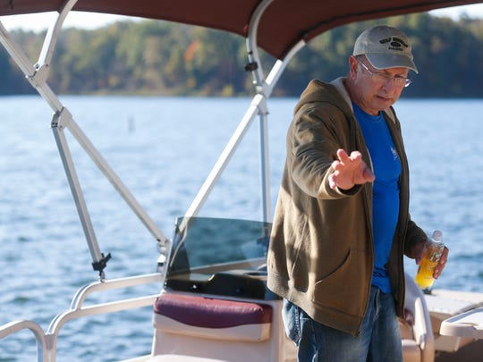 Fellows Lake Marina attendant Phil DeCarlis talks about the safety features on a pontoon boat on Monday, Oct. 24, 2016 that he used to rescue a woman at the lake last week.