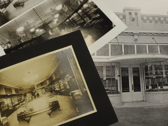 Old photos of previous locations of Holland's Jewelers line the desk of Brant Horner, the company's president. This year marks 100 years in business for the jewelry store.