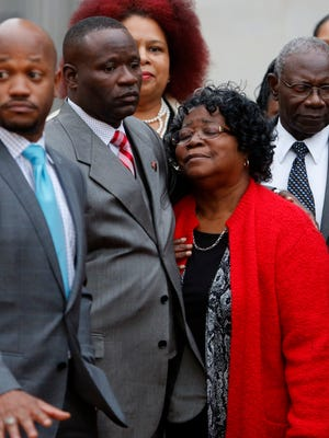 Judy Scott, center, Walter Scott's mother, is comforted by her son Rodney Scott after the mistrial was declared for the Michael Slager trial Monday, Dec. 5, 2016, in Charleston, South Carolina.  Slager, a former patrolman, had been charged with murder in the shooting death of Walter Scott last year. (AP Photo/Mic Smith)