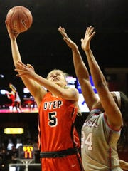 UTEP's Zuzanna Puc, 5, takes a one-handed shot over Alexus Malone of Louisiana Tech Saturday in the Don Haskins Center.