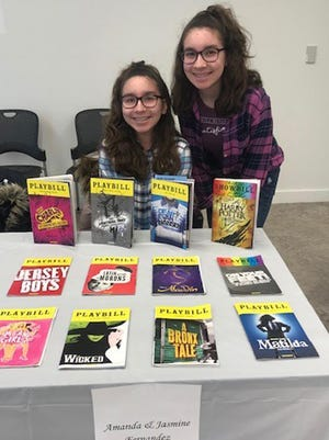 Amanda and Jasmine Fernandez displayed their collection of playbills.