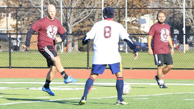 Clifton coach Stan Lembryk (left) playing in the 2015 alumni soccer game.