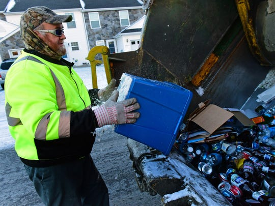 Paul Poe, Waste Management, collects recyclables Wednesday morning, Jan. 13, 2016. To make it easy for Chambersburg's 11,000 utility customers to do just that, a new single stream recycle program is underway in the borough.