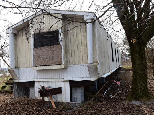 Fire damage is seen at a mobile home Wednesday, March