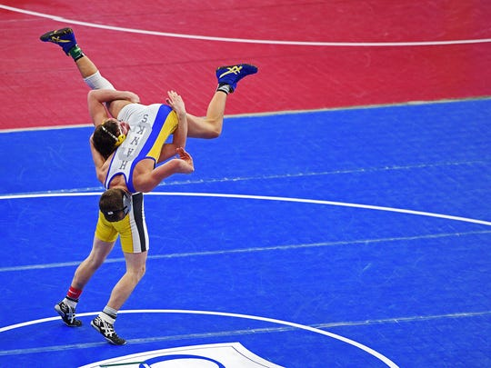 Faulkton Area's Alex Aesoph, bottom, wrestles Canton's
