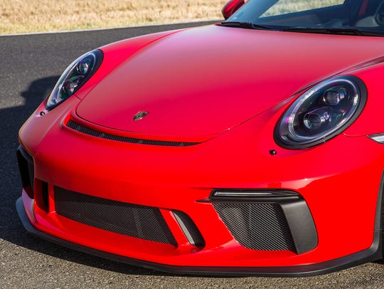 The deep front spoiler of the 911 GT3 is so low that scraping it is a constant worry. But the company does offer an optional hydraulic lift which raises the nose at the push of a button, virtually a must for this low-slung racer.