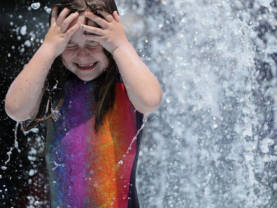 Angela Tabisz, 6, of Bergen County beats the heat at