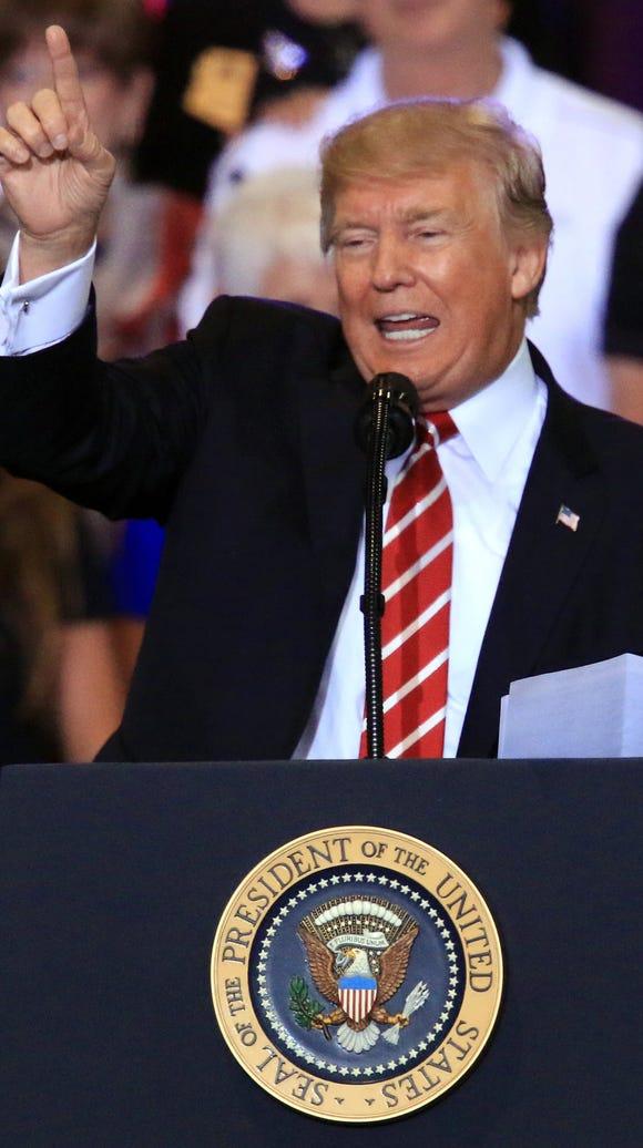President Donald Trump addresses a crowd in Phoenix,