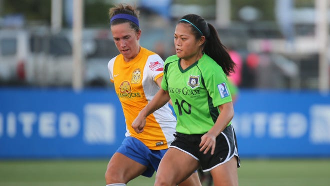 NAPA Rovers' Laura Nadeau looks for an opportunity to gain possession of the ball from Bank of Guam Lady Strykers' Koharu Minato in a Round 1 match of the Bud Light Women's Soccer League playoffs Nov. 27, 2016 at the Guam Football Association National Training Center. The Rovers won 2-0 and will face top-ranked Personal Finance Center Lady Crushers in the semifinals Dec. 4.