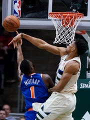 Milwaukee Bucks' Giannis Antetokounmpo blocks New York Knicks' Emmanuel Mudiay's shot during the second half of an NBA basketball game Friday, March 9, 2018, in Milwaukee. The Bucks won 120-112.