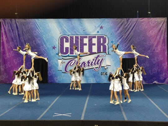 """Padua Academy's varsity and junior varsity cheerleading teams won the """"Cheer for Charity"""" competition."""