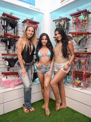 From left, Sandrine Cruz Stewart, owner, Victoria Espaldon, and Abigail Tamayo, offer service with a smile at Chamorrita Swimwear in the Plaza in Tumon on May 18.
