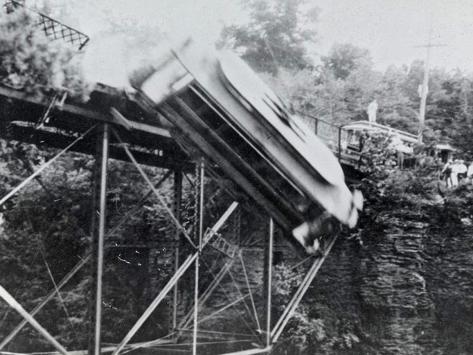 """A trolley flies off the Stewart Ave. bridge over Fall Creek Aug1, 1914 during the filming of the Wharton brothers film, """"Kiss of Blood"""" later released as """"The Prince of India."""" The picture was taken by Allan H. Treman a Cornell University law student at the time."""