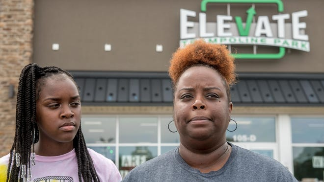 Gyreasha Linwood, right, and her daughter Kamren, 14, speak during a news conference Tuesday, June 30, 2020 about an incident Saturday night in which a racial slur was used against Kamren at Elevate Trampoline Park in East Peoria.