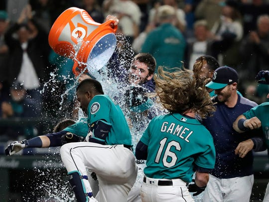 The Seattle Mariners celebrate after Mitch Haniger's