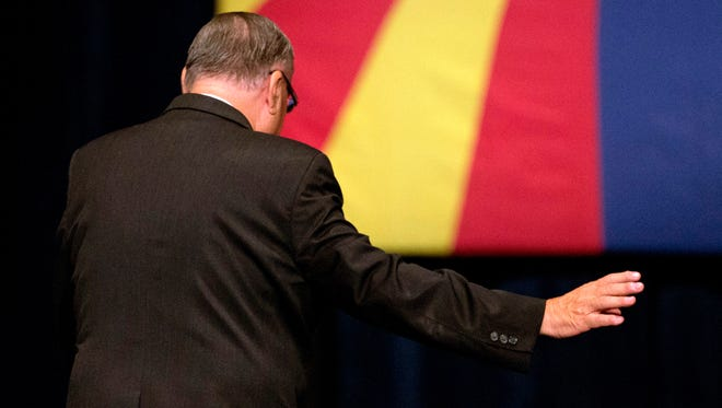 Sheriff Joe Arpaio waves to a crowd of thousands after speaking during a rally for presidential candidate Donald Trump at the Phoenix Convention Center on July 11, 2015.