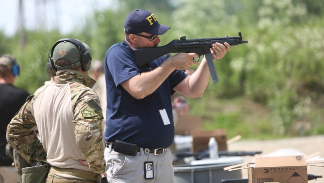 Enquirer reporter James Pilcher participates in the FBI Citizens Academy's Range Day.