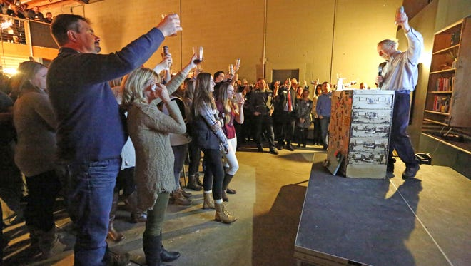 Larry Hutt toasts a life well lived, to his daughter Denver Hutt, during her celebration of life at The Speak Easy on Thursday Jan. 21, 2016. Denver Hutt, who ran The Speak Easy, a nonprofit clubhouse for entrepreneurs for three years, died Jan. 16 at the age of 28 from ovarian cancer.