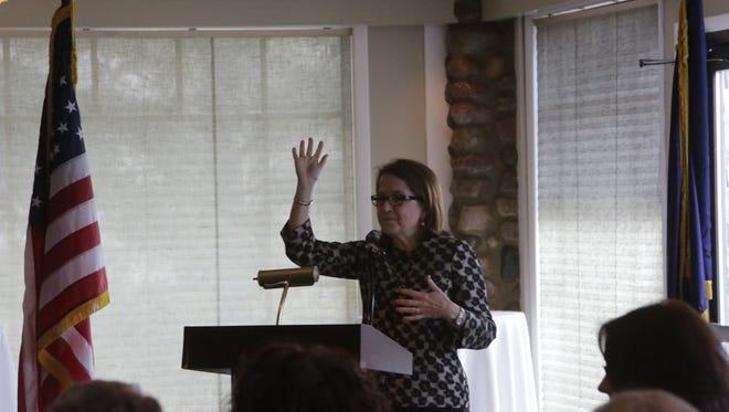 Indiana Supreme Court Chief Justice Loretta Rush asks the crowd Tuesday, Feb. 9, 2016, to raise hands if part of the Tippecanoe County Court Appointed Special Advocates staff. Rush spoke at a meeting of the local chapter of civic group Daughters of the American Revolution.