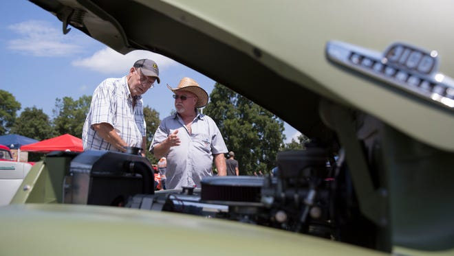 Virgil Jones and Nathan Brindley (left to right) checkout a 3100 series Chevy during the annual Frog Follies car show on Saturday afternoon.