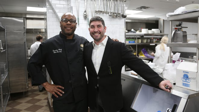 Executive Chef Rick Hussey, left, and proprietor George Sboukis of the Caucus Club, set to re-open in Detroit's Penobscot Building.