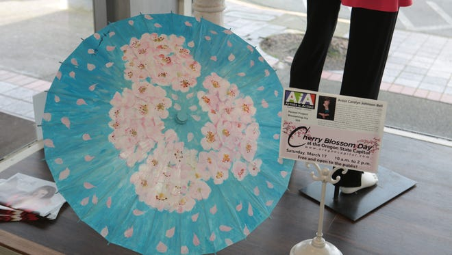 """Artists in Action has coordinated the """"Parasol Project"""" art display at downtown locations to be shown throughout March."""