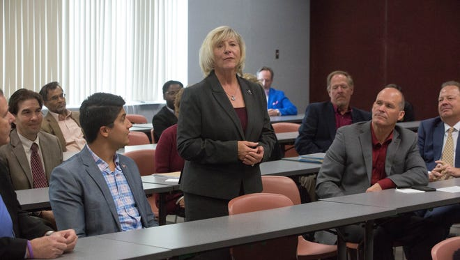 Debra Hicks, chair of the New Mexico State University regents, takes questions about the search for a new NMSU chancellor Tuesday April 3, 2018 at the Senate Gallery Room at Corbett Center. Eleven of the 19-member chancellor search committee were in attendance at the news conference.