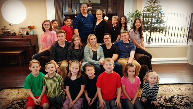 As parents to 18 children – a mix of biological children, adopted children and foster children, ages 3 to 18 – Shelly and Jared Wallace have their hands full.