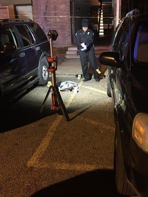 JPD investigators process the shooting scene at 225 W. McDowell Road.